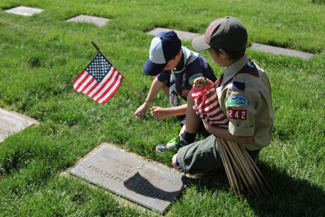 Photos memorial day flag placement ceremony at calverton for Proper placement of american flag
