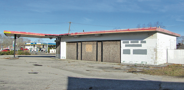This boarded-up former gas station in Riverside is one of nine properties to be cleaned up using grant money awarded to Southampton Town.