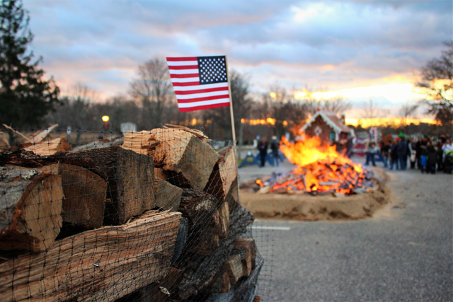 The American flag flies at the Riverhead Business Improvement District's Holiday Bonfire Saturday evening. (Credit: Elizabeth Wagner)