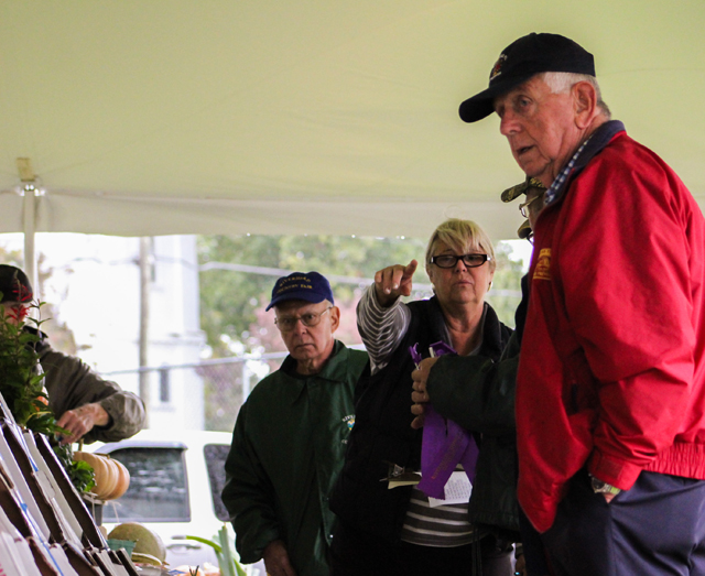 Judges deliberate on the Farm and Garden 'Best in Show' awards.