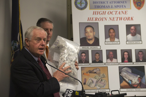 Suffolk County District Attorney Thomas Spota holds up a bag of heroin seized during a drug raid that busted an alleged heroin network. (Credit: Paul Squire)
