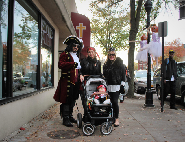 Little Caden Jarrett (boy in stroller) with his pirate crew: father Cory Jarrett (of Medford), mother Monica Fernandez (of Medford), and grandmother Ileana Giambone (of Southampton).