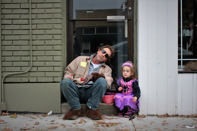 James Rooney and daughter Honora take a break from trick-or-treating to enjoy some hard-earned candy. Both from Aquebogue. James is dressed as the Big Bad Wolf and Honora is dressed as Spider Girl.