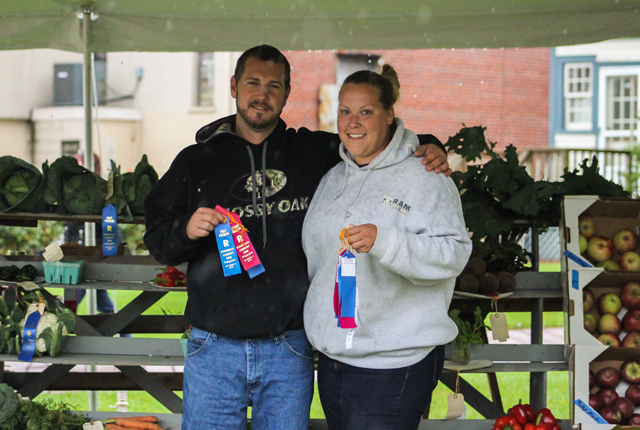 Sara Hodun of Hodun Farms in Calverton (right) won 16 ribbons in commercial growing.