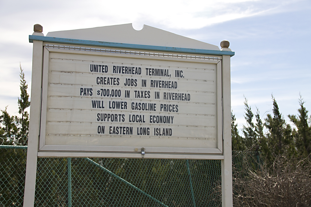 Who owns this sign?If you ask a local community group or a oil terminal, they'll both say they do. (Credit: Paul Squire)