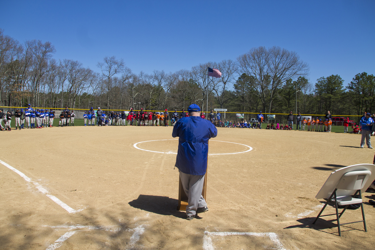 Little League president Tony Sammartano addresses the teams during his last Opening Day. (Credit: Paul Squire)