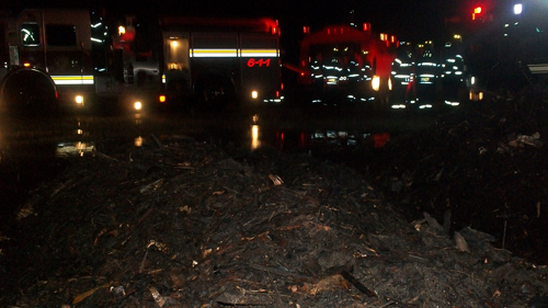 JAMESPORT FIRE DEPARTMENT COURTESY PHOTO | FIrefighters at the scene of Wednesday's mulch fire.