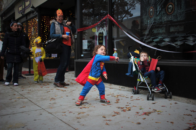 Superman Liam of Long Beach rocking out to the DJ in front of Vines & Hops.