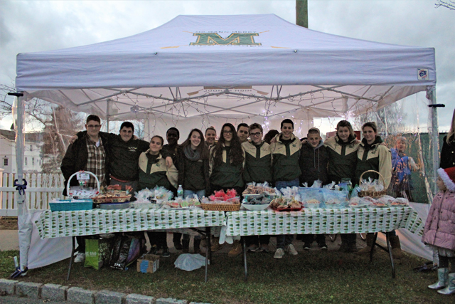 The Bishop McGann-Mercy Diocesan High School Crew Team raising money with a holiday bake sale . (Credit: Elizabeth Wagner)