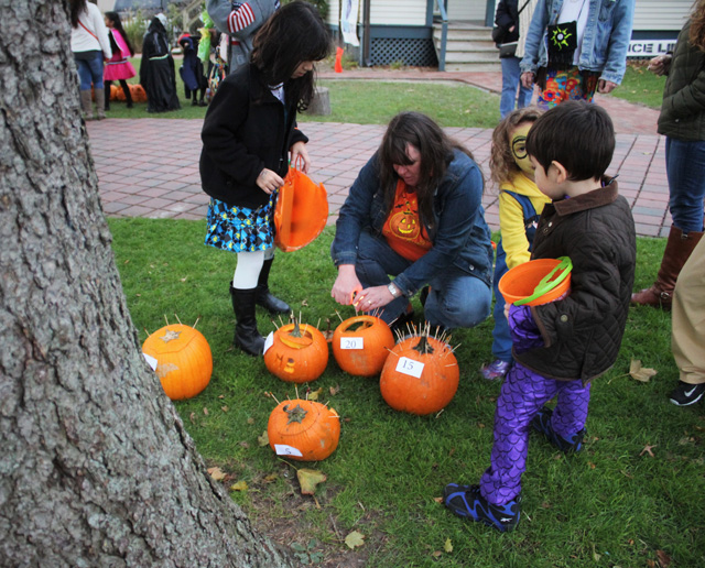 A crowd gathers for lighting of the Jack O'Lanterns.