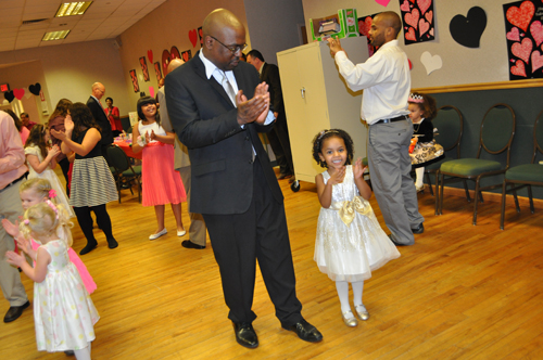James Richardson of Wading River with his 3-year-old daughter, Brynn, at Saturday's dance in Aquebogue. (Credit: Rachel Young photos)