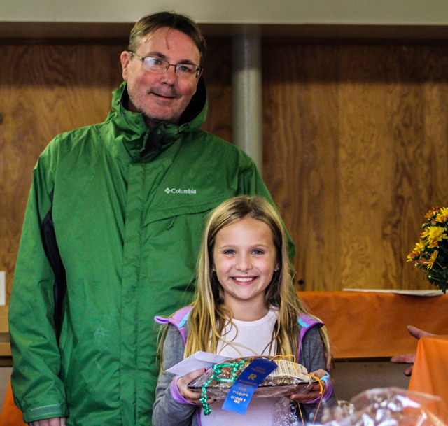 Alexandra Hoverkamp, pictured here with her father Douglas Hoverkamp, won an award for her apple bread.