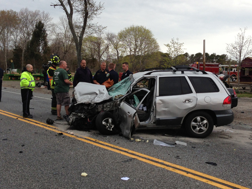 PAUL SQUIRE PHOTO | A woman driving this Hyundai Santa Fe crashed into three other vehicles Monday morning, sending all four drivers to the hospital.