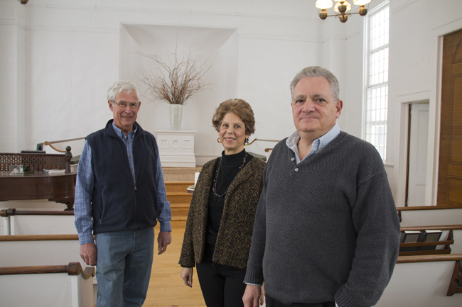 Local historian Richard Wines (left) along with Doris McGreevey and Richard Radoccia stand in the Jamesport Meeting House, where Mr. Radoccia and Ms. McGreevey hope to present a play about the Civil War on the 150th anniversary of its end. (Credit: Paul Squire)