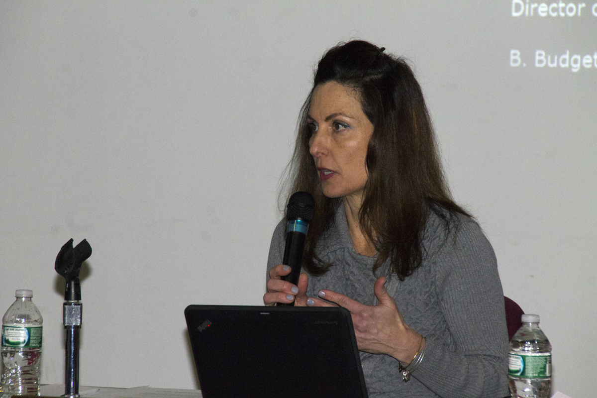 Riverhead school board member Lori Hulse pitches the need to limit the kinds of contracts the district superintendent can sign without board approval at a board meeting Tuesday night. (Credit: Paul Squire)