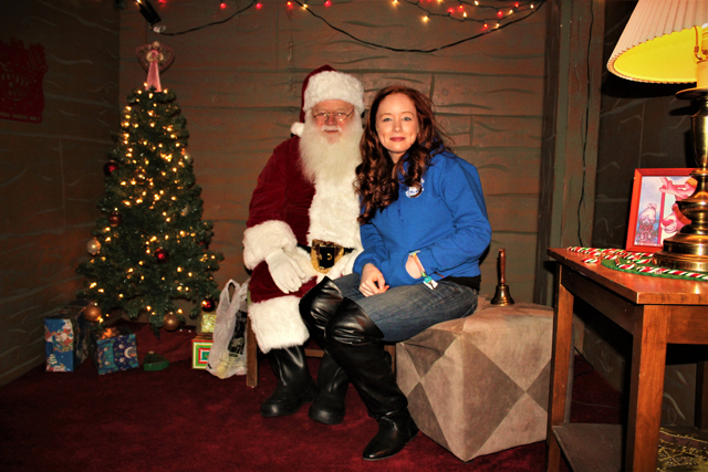 Santa and Melissa Muller of the Riverhead Recreation Department. Melissa took photos of every visit with Santa to be posted on the Riverhead Recreation Department's website. Riverhead Rec also built the Gingerbread House. (Credit: Elizabeth Wagner)