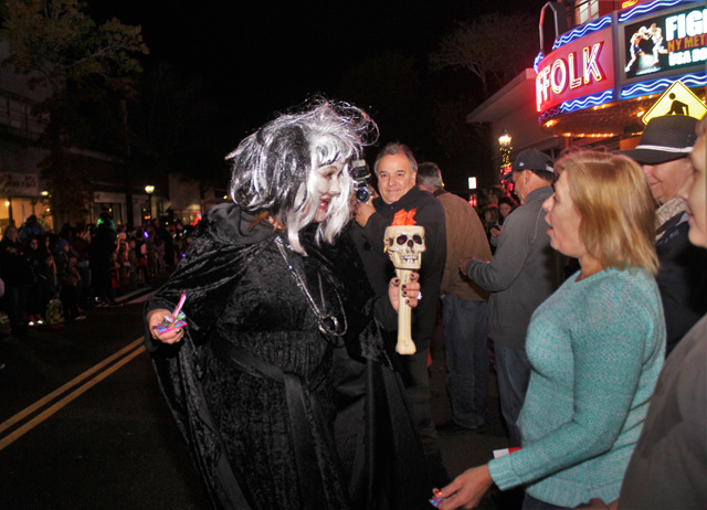 Parade characters spook the crowd by getting up close and personal.