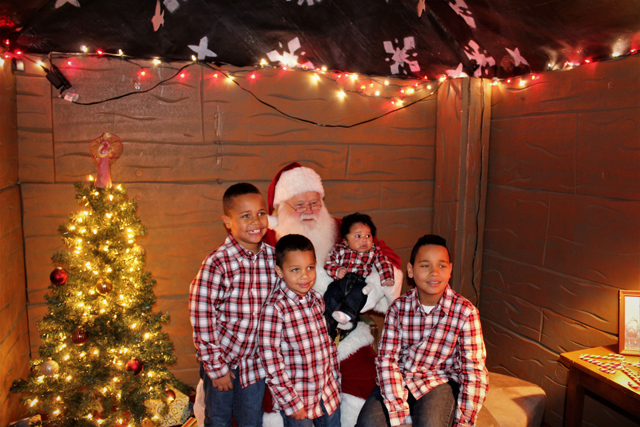 The Gilliam Brothers in matching Christmas outfits – they were the first family to visit with Santa. (Credit: Elizabeth Wagner)