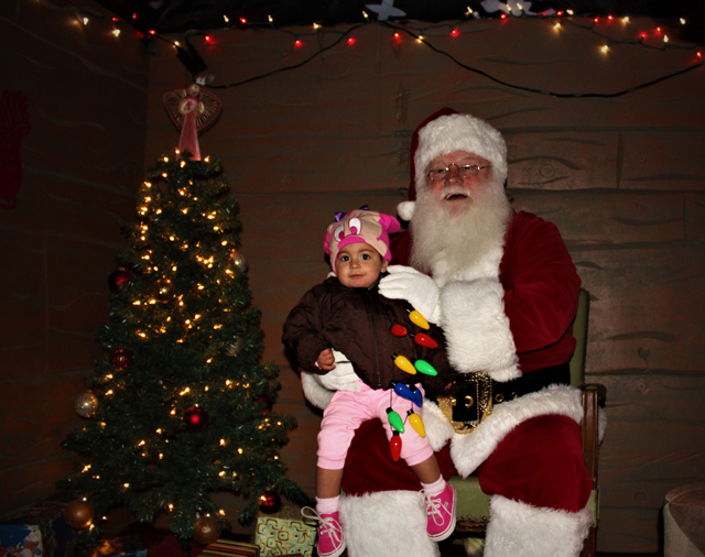 Santa and Vanessa Denoon of Riverhead. (Credit: Elizabeth Wagner)