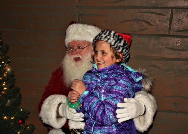 Santa and Natalie Tucci of Riverhead. Natalie tugged Santa's beard to check if it was real. It is! (Credit: Elizabeth Wagner)