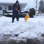 VFW Post 2476 member Ken Kendell volunteered to clear heavy snow from the sidewalks. (Credit: Barbaraellen Koch)