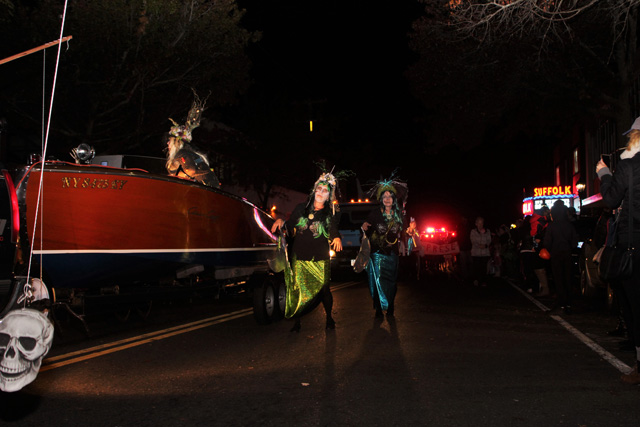 Zombie mermaids shuffling alongside the boat.