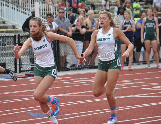 McGann-Mercy senior Delaney Macchirole hands off to Dayna Young in the 4x400 relay Friday. (Credit: Joe Werkmeister)