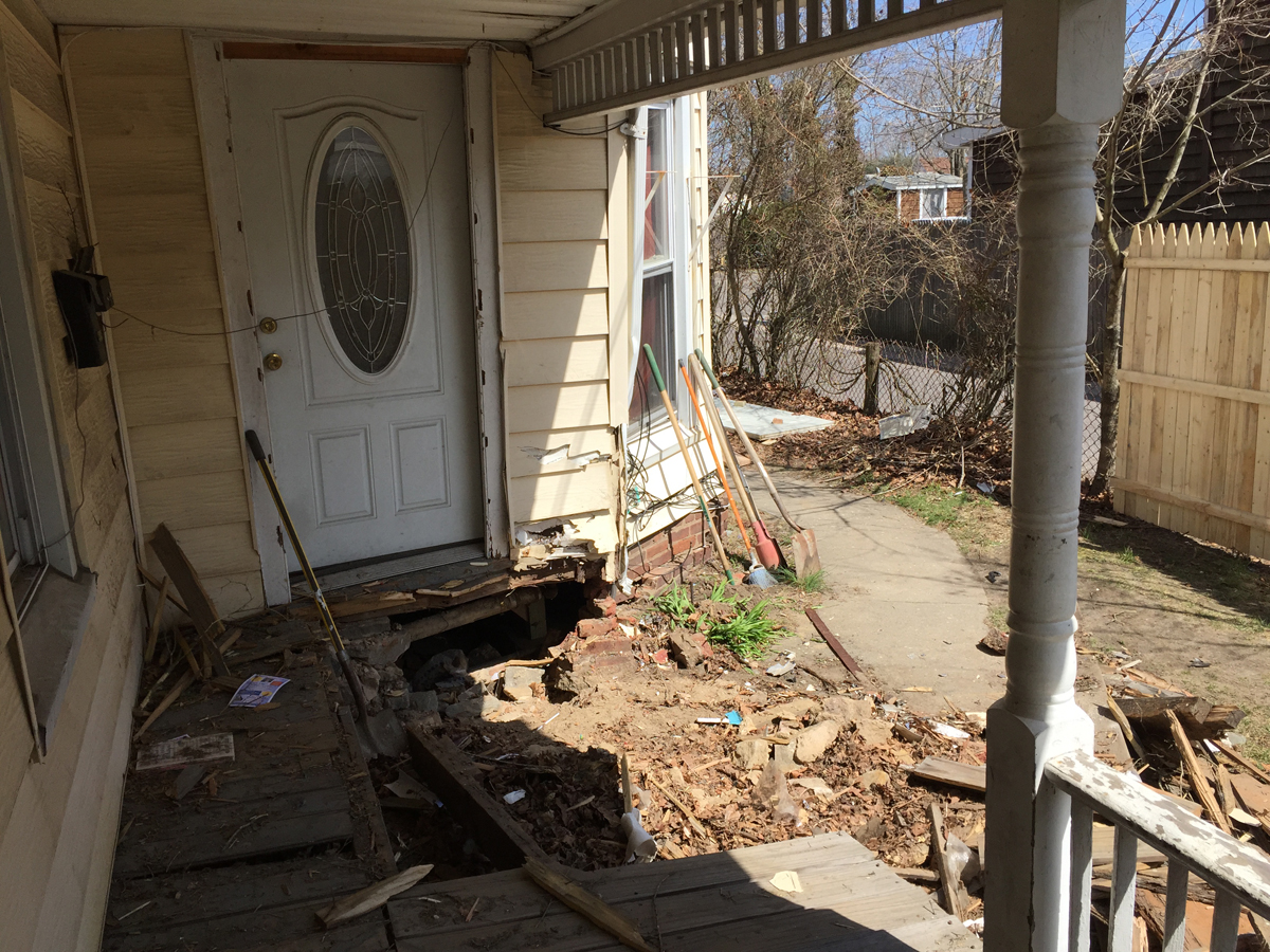 A car crashed into this house on Roanoke Avenue Saturday night. Police have arrested a man they say tried to run away on foot. (Credit: Paul Squire)