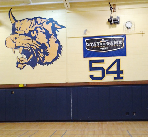 The No. 54 plaque was recently placed on the wall of Shoreham-Wading River High School's gym. (Credit: John Glenn School District)