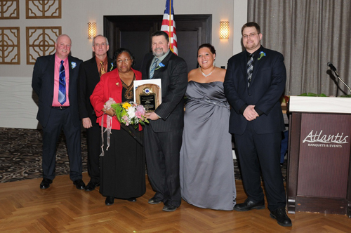 (Courtesy photo) Lifetime achievement award winner Betty Harris (third from left) accepts her award with Corps board members Ron Rowe, Keith Lewin, Bruce Talmage and Kim Pokorney and Chief Joseph Oliver at the corps' dinner Saturday night.