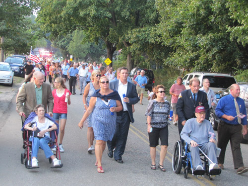The procession walks along Park Road in Reeves Park toward the 9/11 Memorial at the corner of Park and Sound Avenue during last year's procession. (Credit: Tim Gannon)