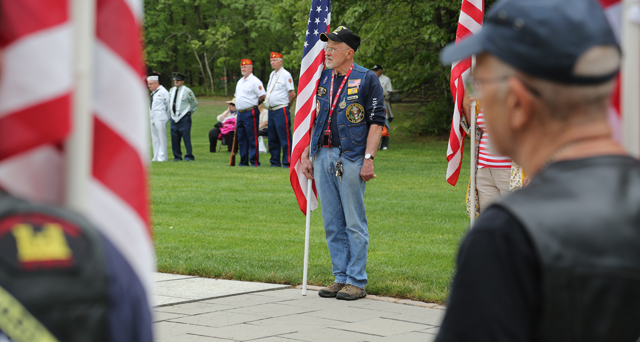 The Patriot Guard Riders stand at attention during Monday's ceremony at Calverton National Cemetery. (Credit: Grant Parpan)