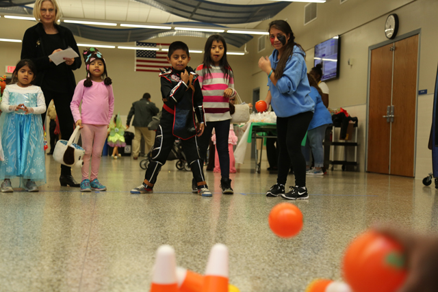 Nine-year-old Luis Aguilar from Aquebogue bowls down candy corn pins at Riverhead High School Key Club's Safe Halloween event.