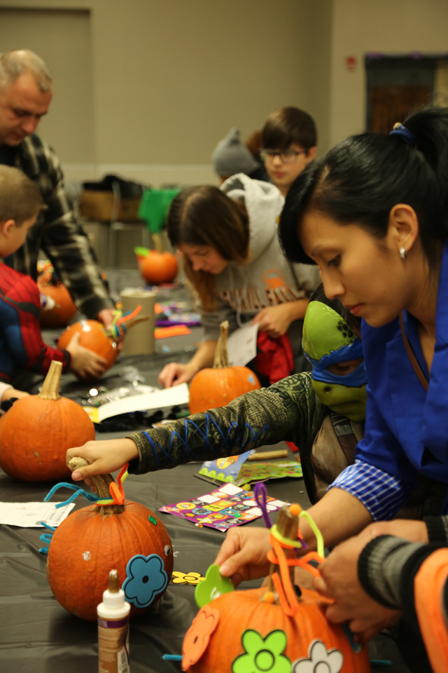 Riverhead High School Key Club's Safe Halloween event included arts and crafts like pumpkin decorating in the school's cafeteria.