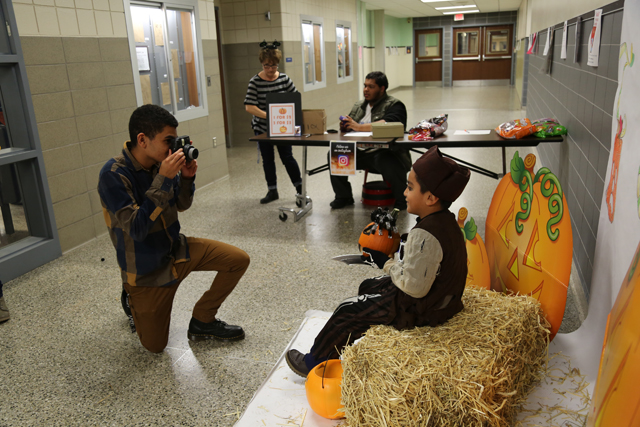 The Safe Halloween event featured activites set up by several Riverhead High School clubs, including the Photo Club's photo shoot on hay bales.