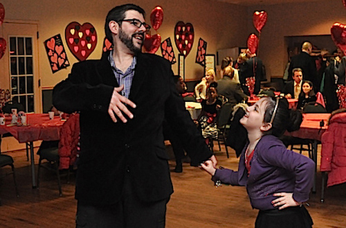 Adam Intravia and his daughter Erin, 8, dance their hearts out. (Cyndi Murray photo)