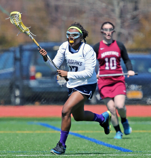 Aneisha Scott, a former Riverhead lacrosse player, played on the conference championship winning St. Joseph's College lacrosse team this spring. (Credit: Daniel De Mato)