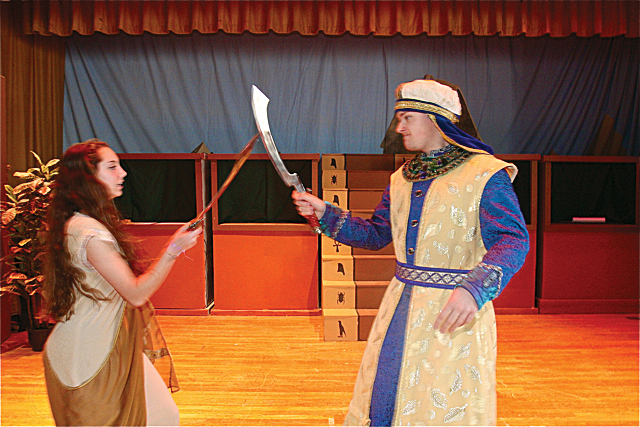 Kate Lewis of Wainscott as Nehebka in a swordfight with Zoser the King of Egypt, played by Ian Byrne of Baiting Hollow. (Credit: Barbaraellen Koch)