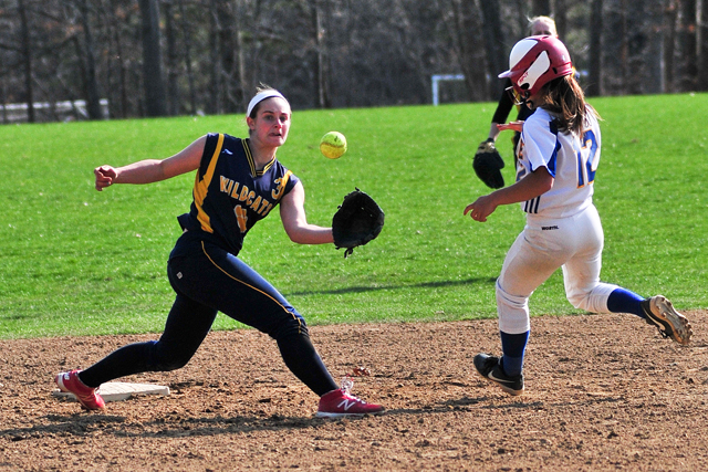 Shoreham-Wading River shortstop Alex Hutchins fields the ball as the Comsewogue runner takes second. (Credit: Bill Landon)