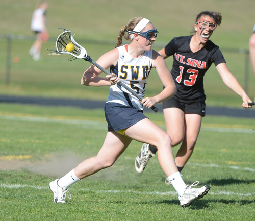 ROBERT O'ROURK PHOTO  |  Shoreham-Wading River junior Jessica Angerman leads the WIldcats against Mount Sinai today in the Class C championship game.