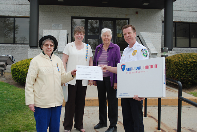 Georgette Case, Anne Otten and Marilyn Runyan of the Daughters of the American Revolution presented Riverhead police chief David Hegermiller a $350 check. (Credit: Riverhead police)