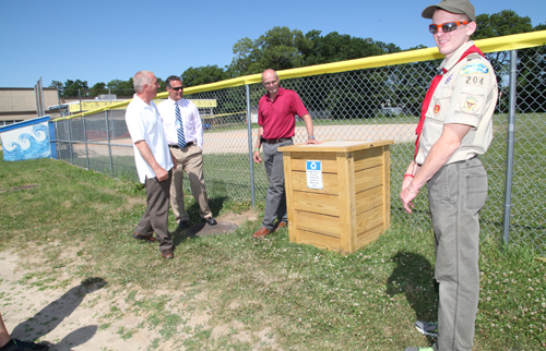 Anthony, right, tk. From left,  Athletic Director Bill Groth, RHS Principal Charles Regan and RHS teacher Tim Paige. (Credit: Courtesy)