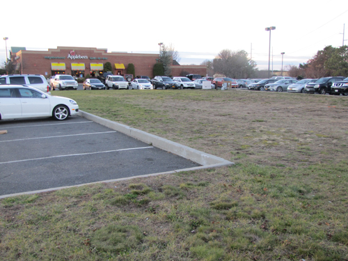 A 7,200 sf retail building is proposed for this grass lot in Applebee's parking on Rt 58