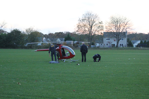 A helicopter crash-landed in an Aquebogue field Sunday afternoon. (Credit: Jen Nuzzo)