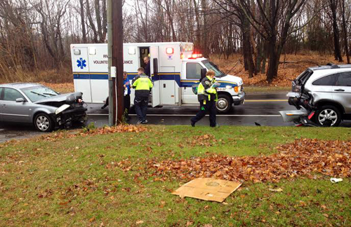 RACHEL YOUNG PHOTO   Two people were taken to Peconic Bay Medical Center Wednesday morning after a sedan rear-ended an SUV in Aquebogue.