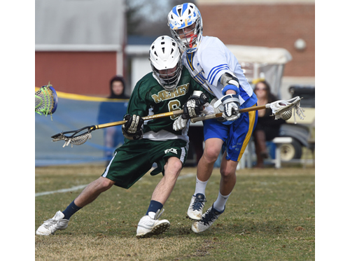 Mercy's Louis Arrester tries to check Mattituck middie Joe Bartolotto. (Credit: Robert O'Rourk)