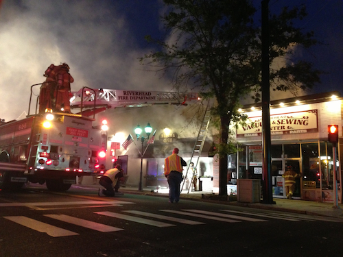 PAUL SQUIRE FILE PHOTO | Emergency crews responded to a fire at Athens Grill on East Main Street.
