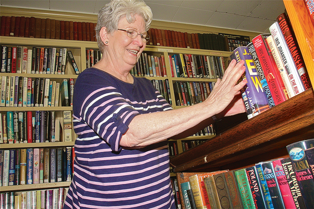 Thelma Stanza has been busy alphabetizing the books inside the tiny Baiting Hollow Library. (Credit: Barbaraellen Koch)