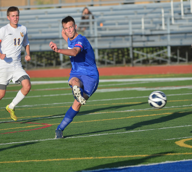 Riverhead junior Phil Barabanov scores the game-winning goal in Monday's win over West Islip. (Credit: Robert O'Rourk)