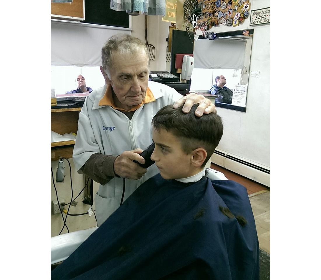 George Kurovics at work in his Rocky Point barbershop. (Credit: Courtesy photo)